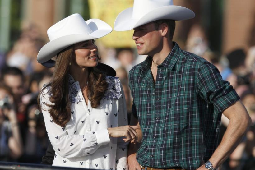 Britain's Prince William and his wife Catherine, Duchess of Cambridge wear western clothes and cowboy hats in Calgary