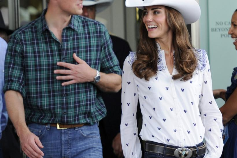 Britain's Prince William and his wife Catherine, Duchess of Cambridge, depart the Calgary Stampede in Calgary.