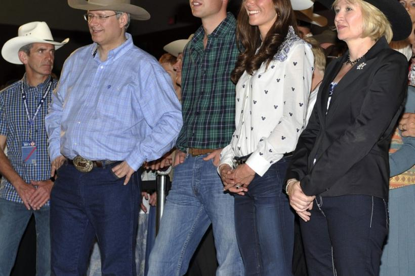Britain's Prince William and his wife Catherine, Duchess of Cambridge, watch dancers with Canadian Prime Minister Harper and his wife Laureen in Calgary
