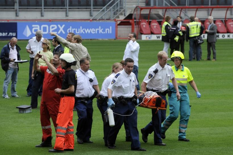 Aid workers carry out a victim after the collapse of a part of a newly constructed roof at the soccer stadium of FC Twente Enschede in Enschede.