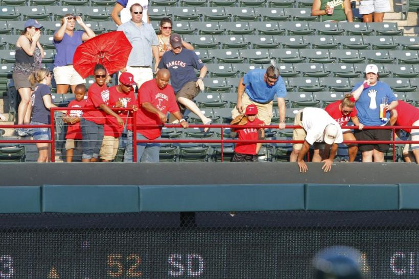 Rangers fans react to another fan, Shannon Stone, falling after trying to reach a foul ball.