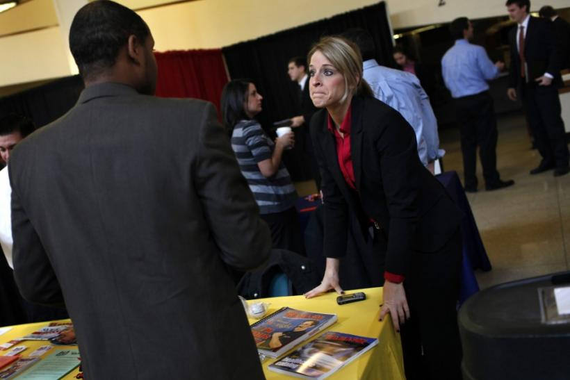 A recruiter for W.B. Mason Inc. speaks with a job seeker at a career fair at Rutgers University in New Brunswick