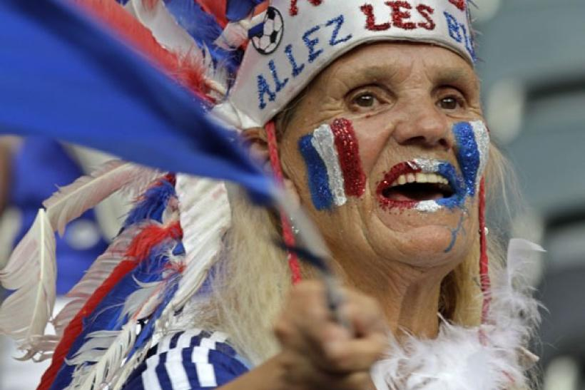 A supporter of France cheers the team