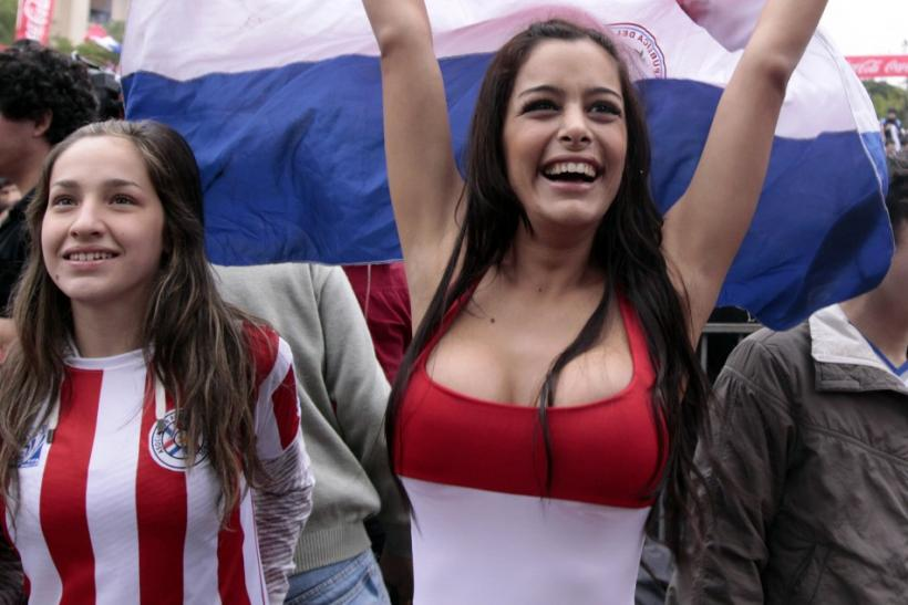 Paraguayan model Larissa Riquelme waves her national flag during a public screening of the World Cup soccer match between Paraguay and Japan in Asuncion