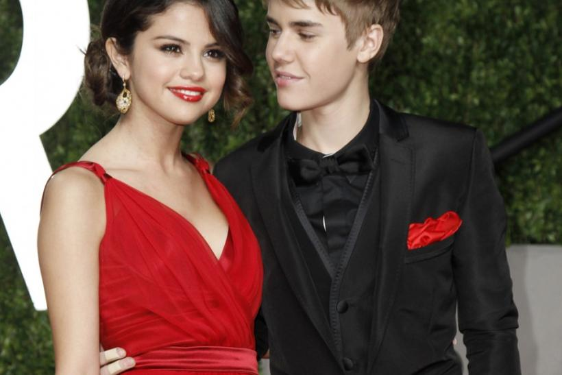 Singer Justin Bieber and singer Selena Gomez arrive at the 2011 Vanity Fair Oscar party in West Hollywood