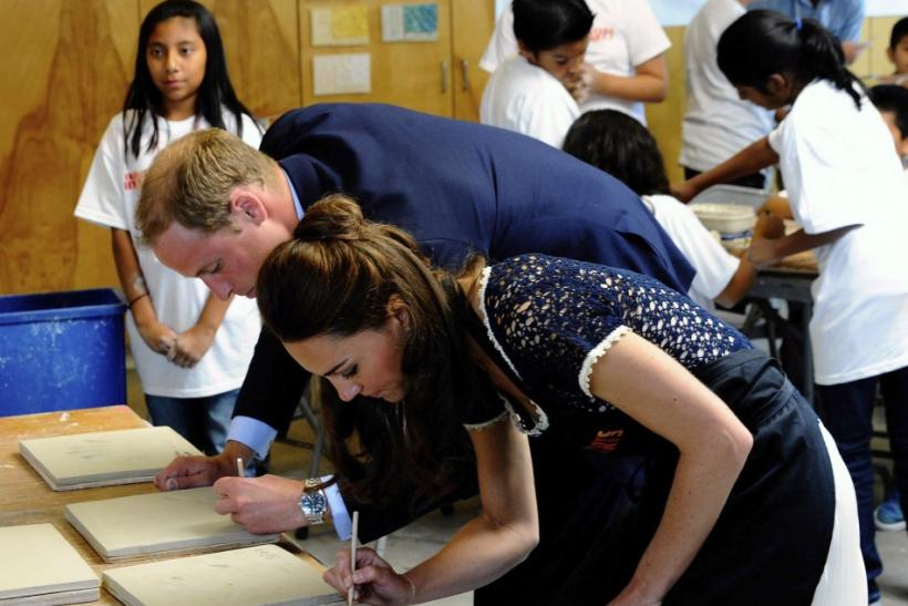 Britain's Prince William and his wife Catherine, Duchess of Cambridge, autograph their handprints after attending a ceramics class at the Inner-City Arts campus in Los Angeles, California