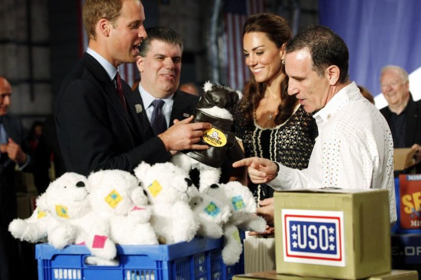 Britain's Prince William (L) and his wife Catherine, Duchess of Cambridge (2nd R), box care packages for the United Services Organizations (USO) with box content designer Trevor Romain at the Mission Serve: Hiring Our Heroes event in Culver City, Californ