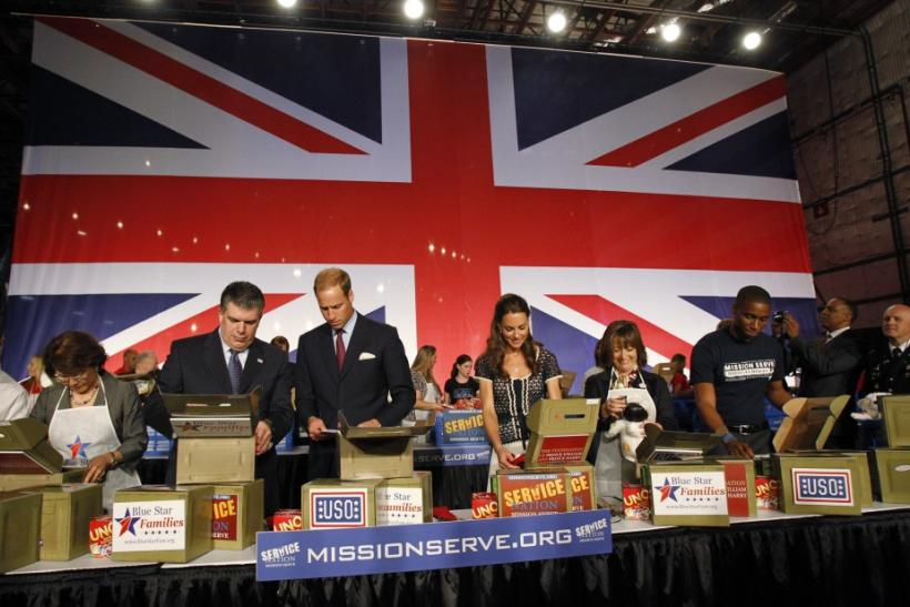Britain's Prince William (3rd L) and his wife Catherine, Duchess of Cambridge (C) , help prepare care packages for military children as they attend the Mission Serve: Hiring Our Heroes event in Culver City, California