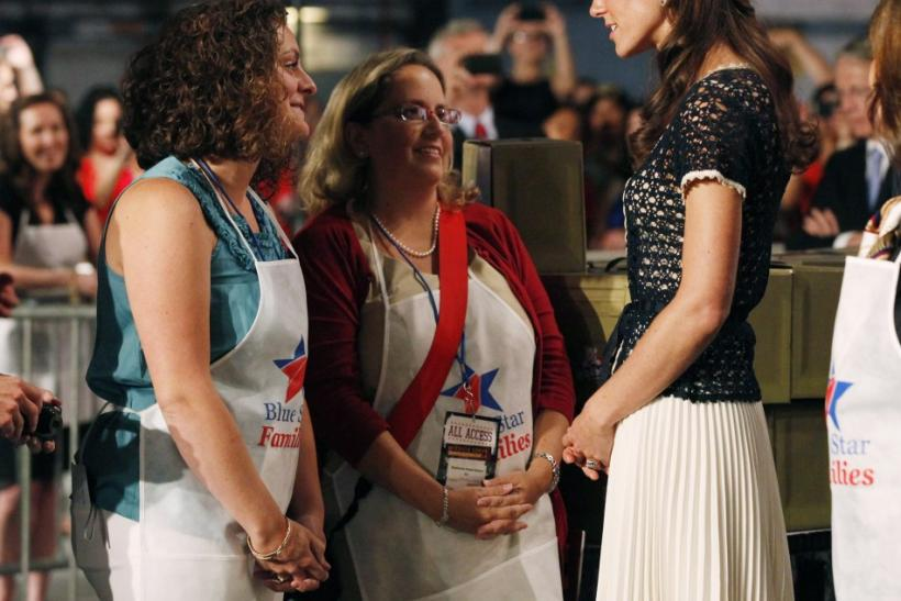 Catherine, Duchess of Cambridge (R) greets volunteers at the Mission Serve: Hiring Our Heroes event in Culver City, California