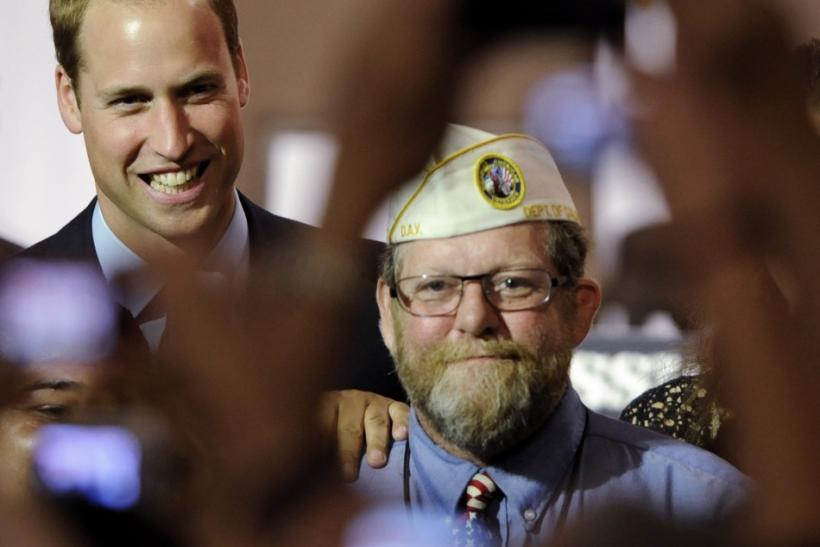Britain's Prince William (L) poses for a photo with a U.S. military veteran as he attends the Mission Serve: Hiring Our Heroes event with his wife Catherine, Duchess of Cambridge (not pictured) in Culver City, California July 10, 2011