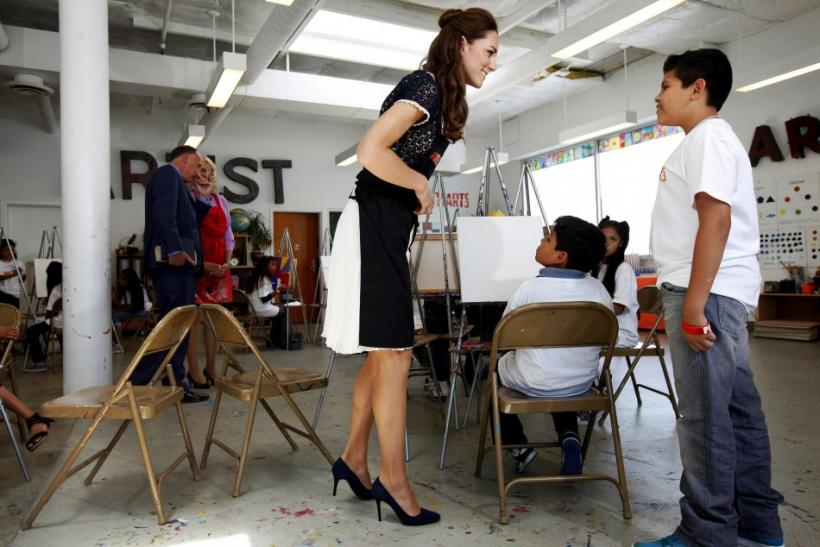 Britain's Catherine, Duchess of Cambridge, talks with students during a tour of the Inner City Arts campus in Los Angeles, California