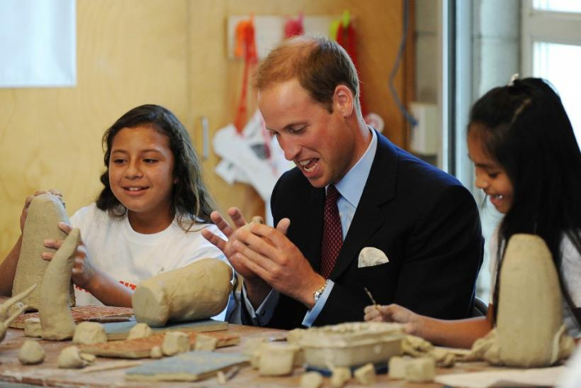 Britain's Prince William works with clay with students during a ceramics class at he Inner-City Arts campus in Los Angeles