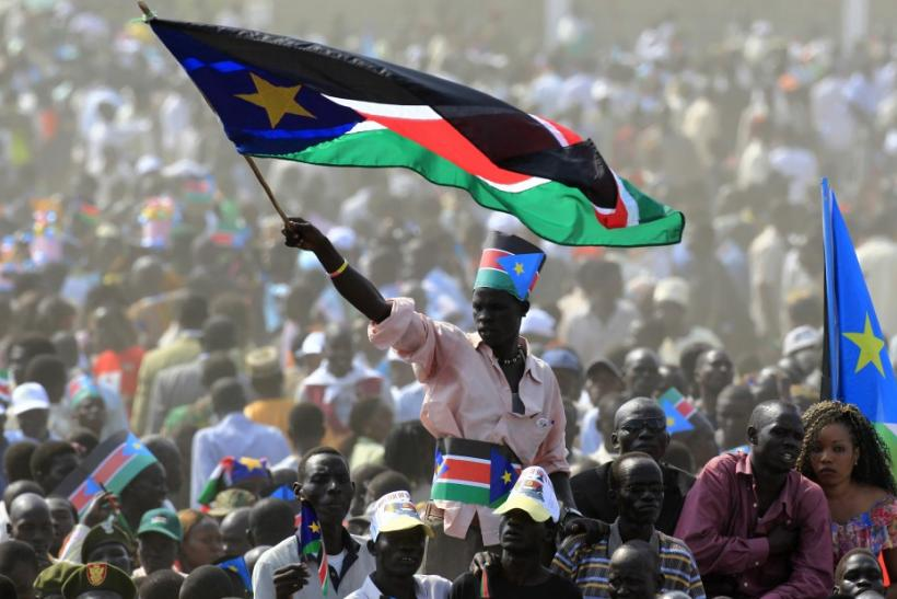 A man waves South Sudan's national flag