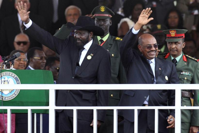 Sudanese Presidents wave to the crowd