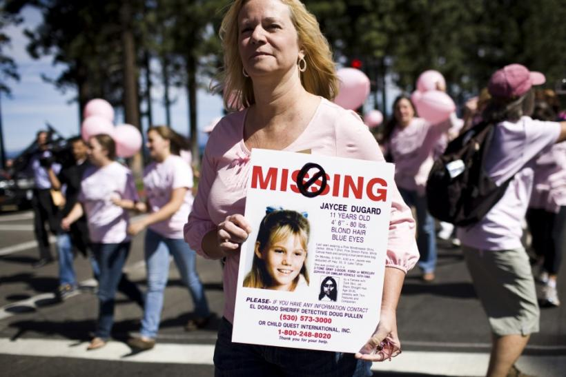 Laurie Ault holds a sign used to publicize the disappearance of Jaycee Dugard during a parade through South Lake Tahoe celebrating the reappearance of Jaycee Dugard