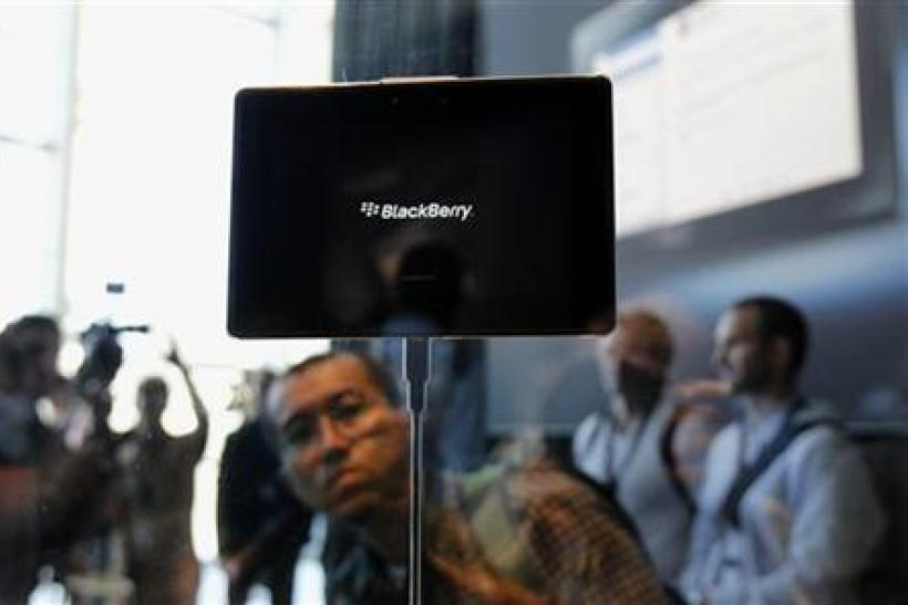 Conference attendees look over the new Blackberry PlayBook at the Research in Motion Blackberry developers conference in San Francisco