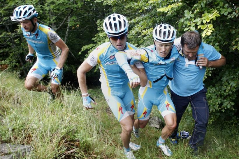 Astana rider is carried by teammates