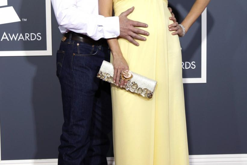 Pregnant Jewel and Ty Murray pose on arrival at the 53rd annual Grammy Awards.