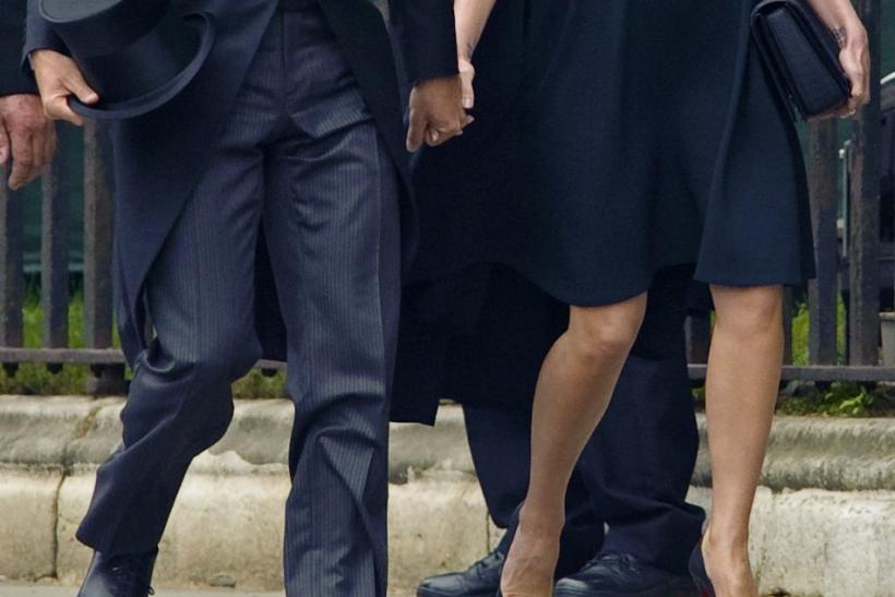 British soccer player David Beckham and his wife Victoria arrive at Westminster Abbey before the wedding of Britain's Prince William and Kate Middleton, in central London