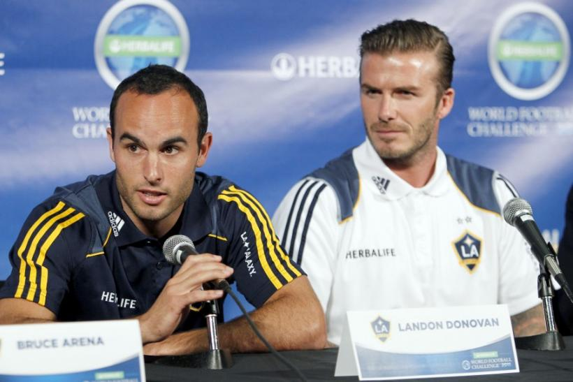 LA Galaxy's Landon Donovan (L) speaks a news conference with teammate David Beckham in Los Angeles