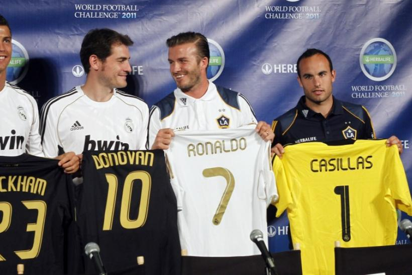 Real Madrid's Ronaldo and Casillas stand next to LA Galaxy's Beckham and Donovan in Los Angeles