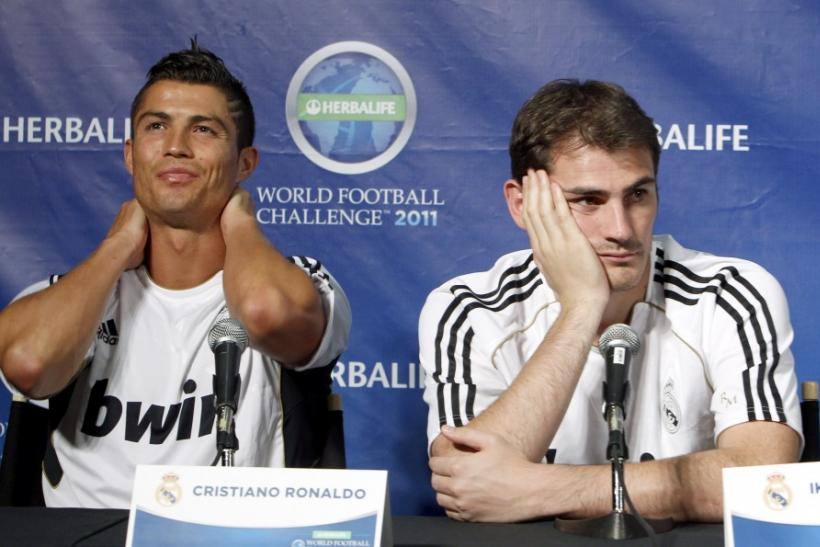 Real Madrid's Cristiano Ronaldo and Iker Casillas attend a news conference in Los Angeles
