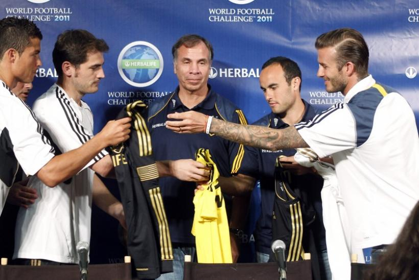 Real Madrid and LA Galaxy players exchange jerseys at a news conference in Los Angeles