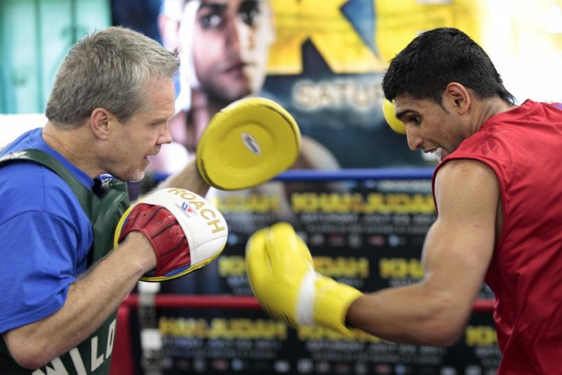 "British boxer Amir ""King"" Khan spars with trainer Freddie Roach at Wildcard Boxing Club in Los Angeles"