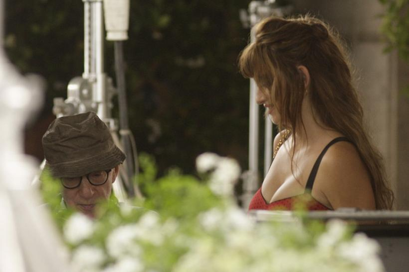 U.S. director Woody Allen (L) talks with actress Penelope Cruz