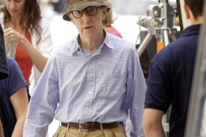U.S. director Woody Allen walks during the shooting of his next movie