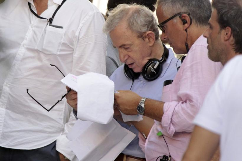 U.S. director Woody Allen reads during the filming of his next movie