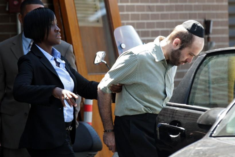 Murder suspect Levi Aron is escorted out of a New York Police Department precinct in Brooklyn