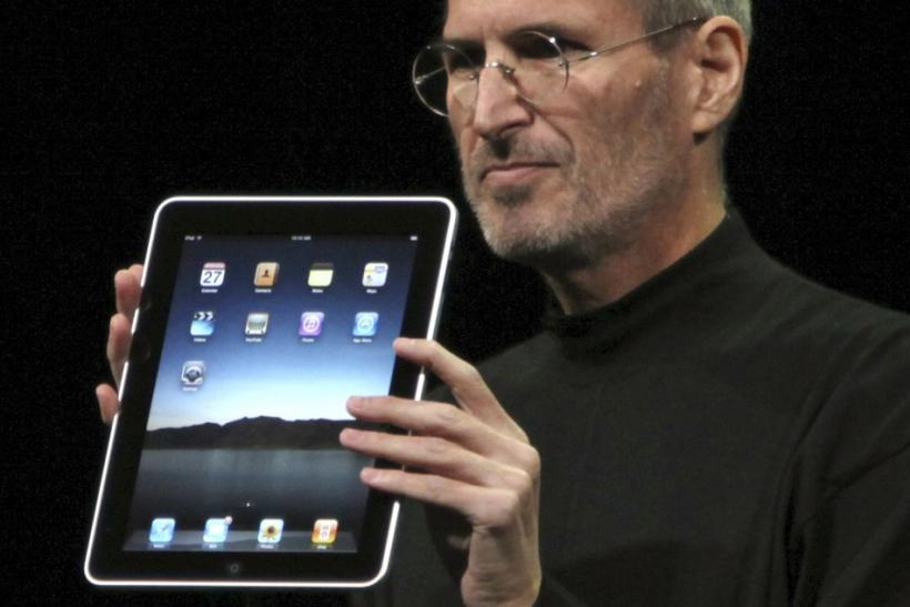 Former Apple CEO Steve Jobs with iPad