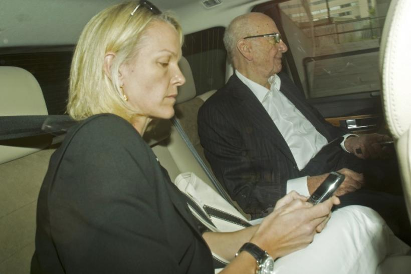 News Corporation CEO Rupert Murdoch and his daughter Elisabeth are driven away from the News International headquarters in London
