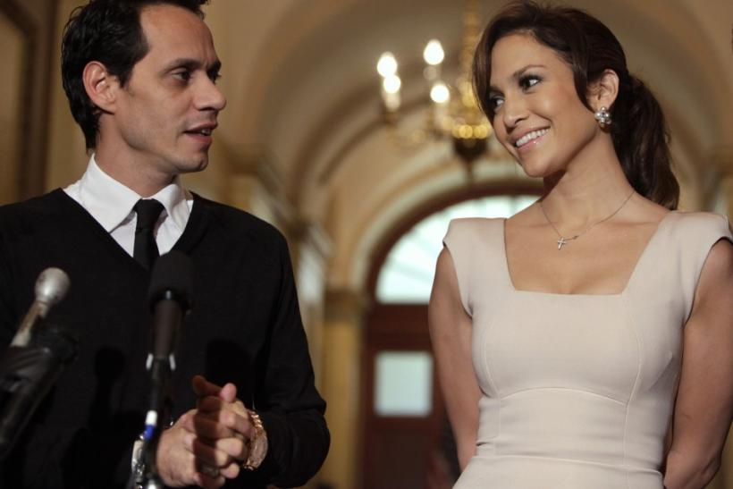 Actress Jennifer Lopez and her husband singer Marc Anthony face reporters before a meeting with House Speaker Pelosi