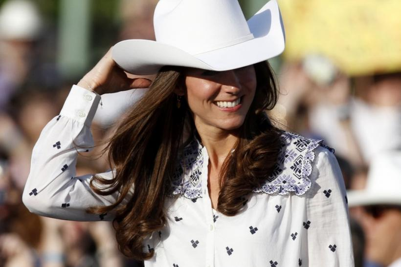 Catherine, Duchess of Cambridge, adjusts her cowboy hat as she attends a Canadian government reception in Calgary