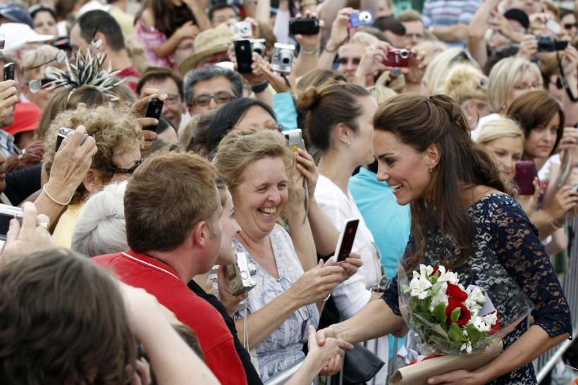 The Duchess of Cambridge Kate Middleton greets admirers following a ceremony at the National War Memorial in Ottawa