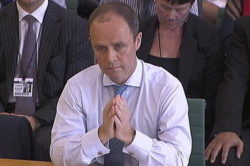 Metropolitan Police assistant commissioner John Yates appears before a parliamentary hearing into phone hacking in London