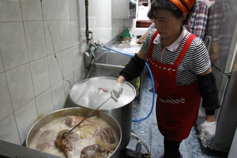 Woman cooks dog meat