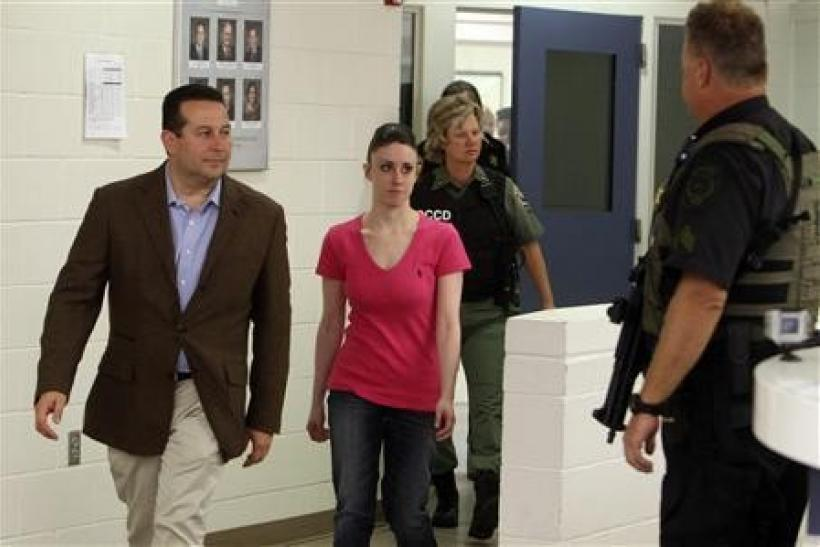 Casey Anthony and her lawyer Jose Baez (L) leave the Orange County Jail in Orlando, Florida