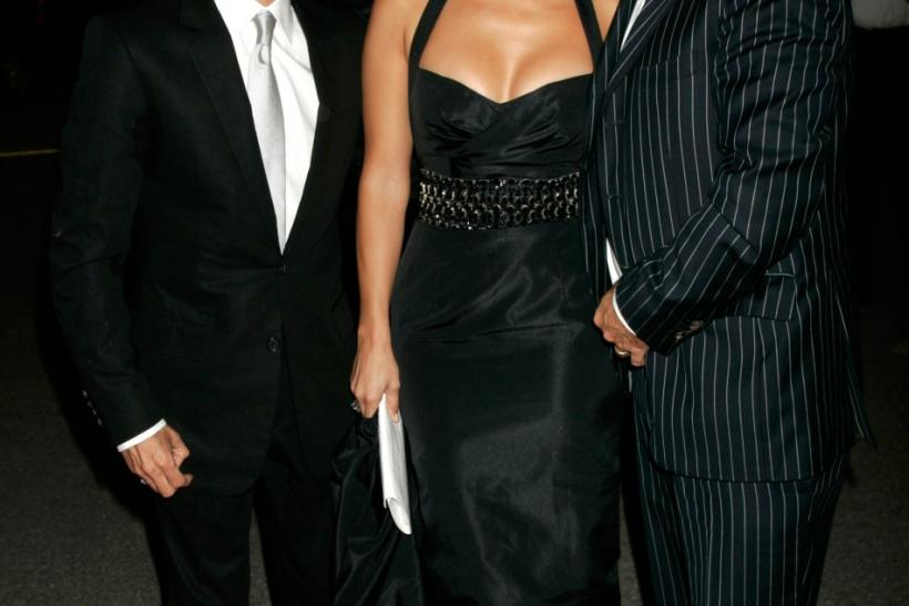 Actress Lopez and her husband and singer Anthony pose with Hilfiger at Macy's Passport 05 fashion show in Santa Monica