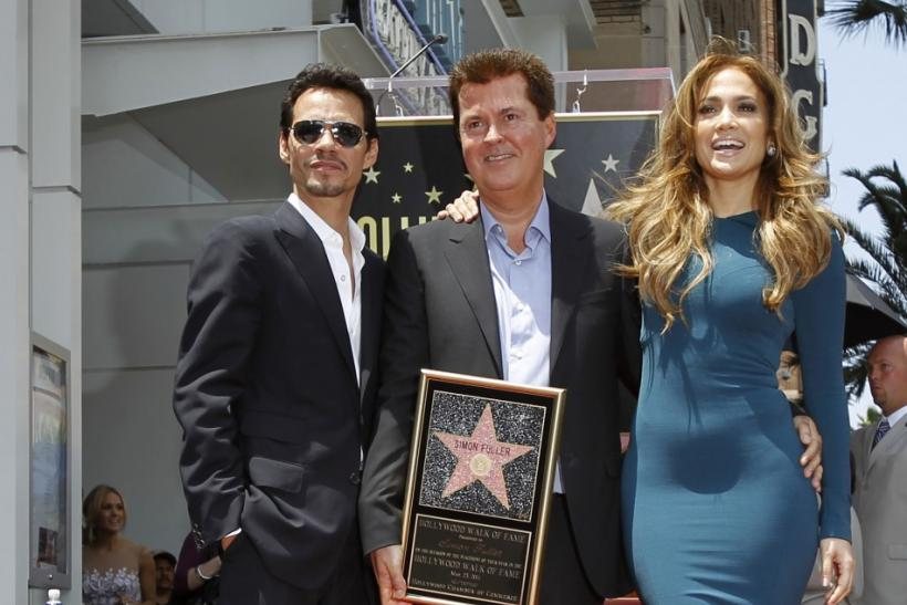 Fuller poses with Lopez and her husband Anthony after he was honored with a star on the Walk of Fame in Hollywood 23/05/2011