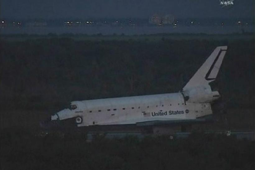 The space shuttle Atlantis sits on the runway in the early morning light after a night landing at the Kennedy Space Center in Florida in this image from NASA TV July 21, 2011.