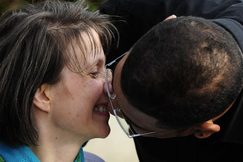 British multiple sclerosis sufferer Debbie Purdy and her husband Omar Puente kiss outside of the House of Lords in central London