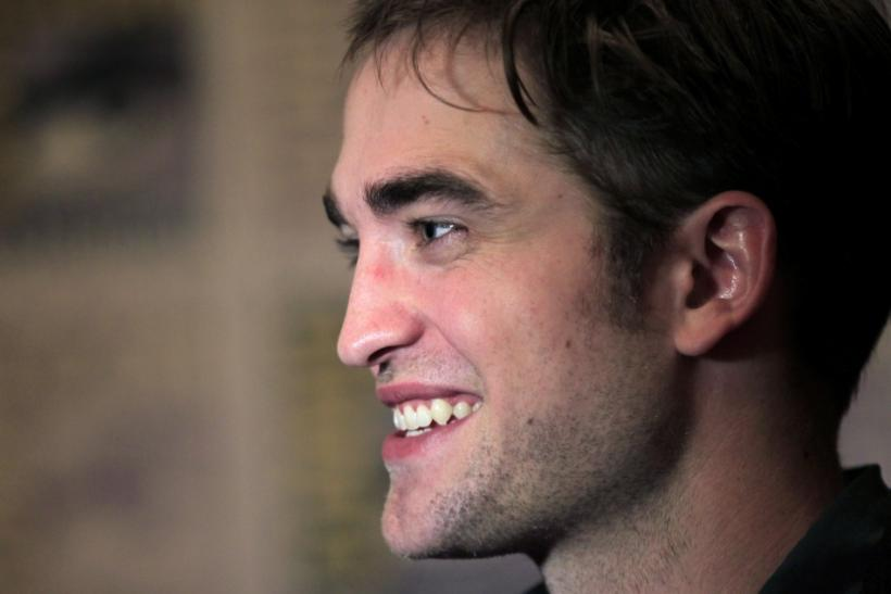 "Actor Robert Pattinson poses to promote ""Breaking Dawn"" from the Twilight Saga at Comic Con in San Diego, California"