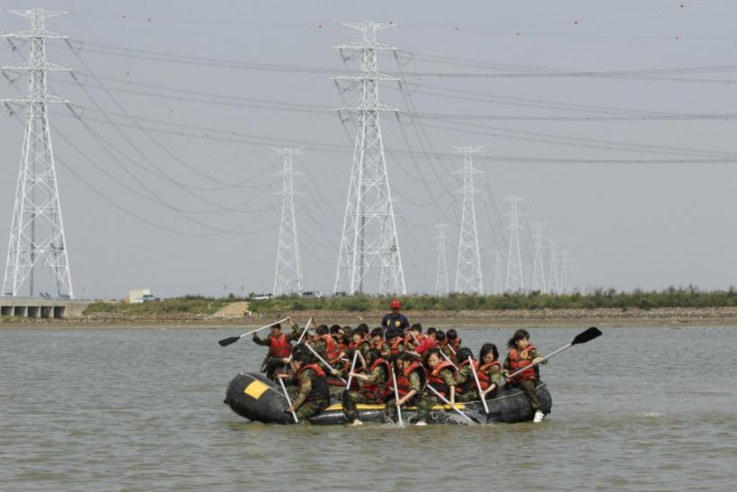 Elementary school students row rubber boats as they participate in a summer military camp at the Cheongryong Self-denial Training Camp in Ansan