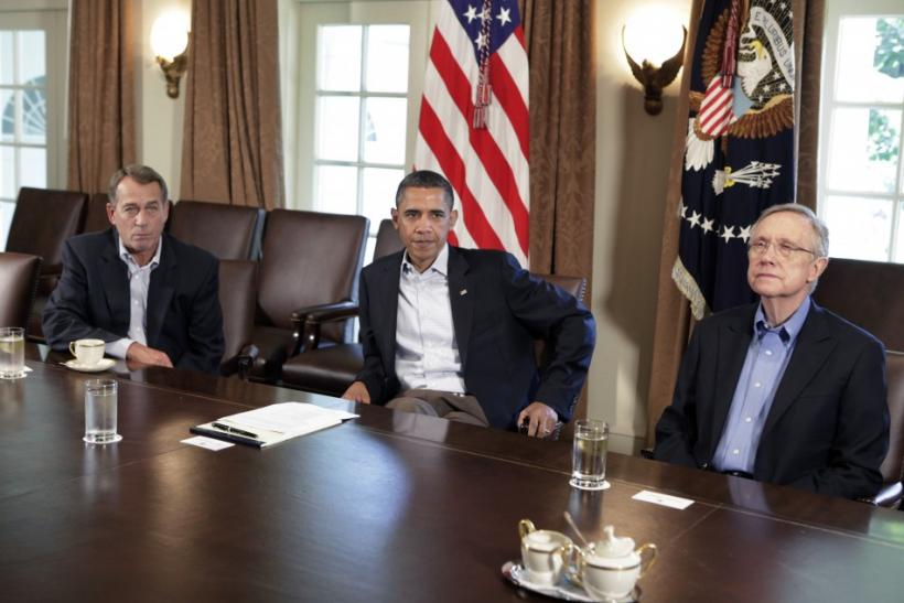 President Barack Obama (C) sit with House Speaker John Boehner (R-OH) (L) and Senate Majority Leader Harry Reid
