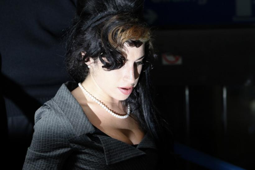 British singer Amy Winehouse leaves Westminster Magistrates Court in London July 23, 2009
