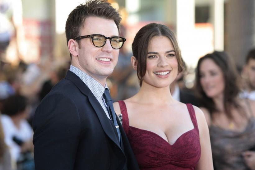 "Evans and Atwell pose as they arrive at the ""Captain America: The First Avenger"" film premiere in Hollywood"