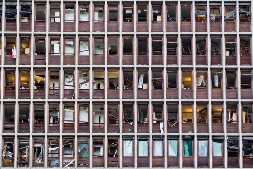 The shattered windows of a government building are seen in Oslo, following Friday's bombing